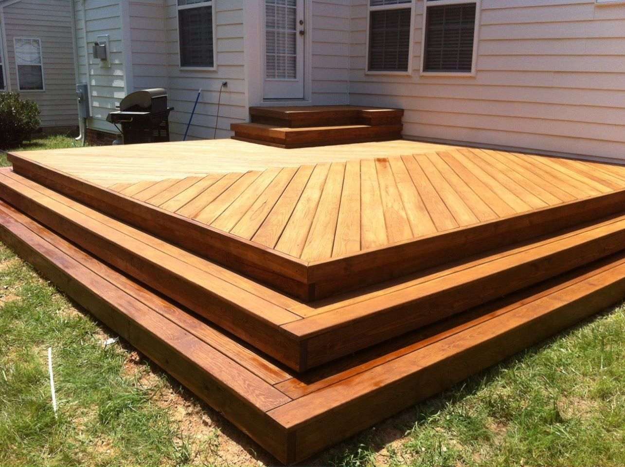 New Deck With Herringbone Decking Pattern No Railing With Wrap Around Steps Patio Deck Designs Diy Deck Deck Designs Backyard