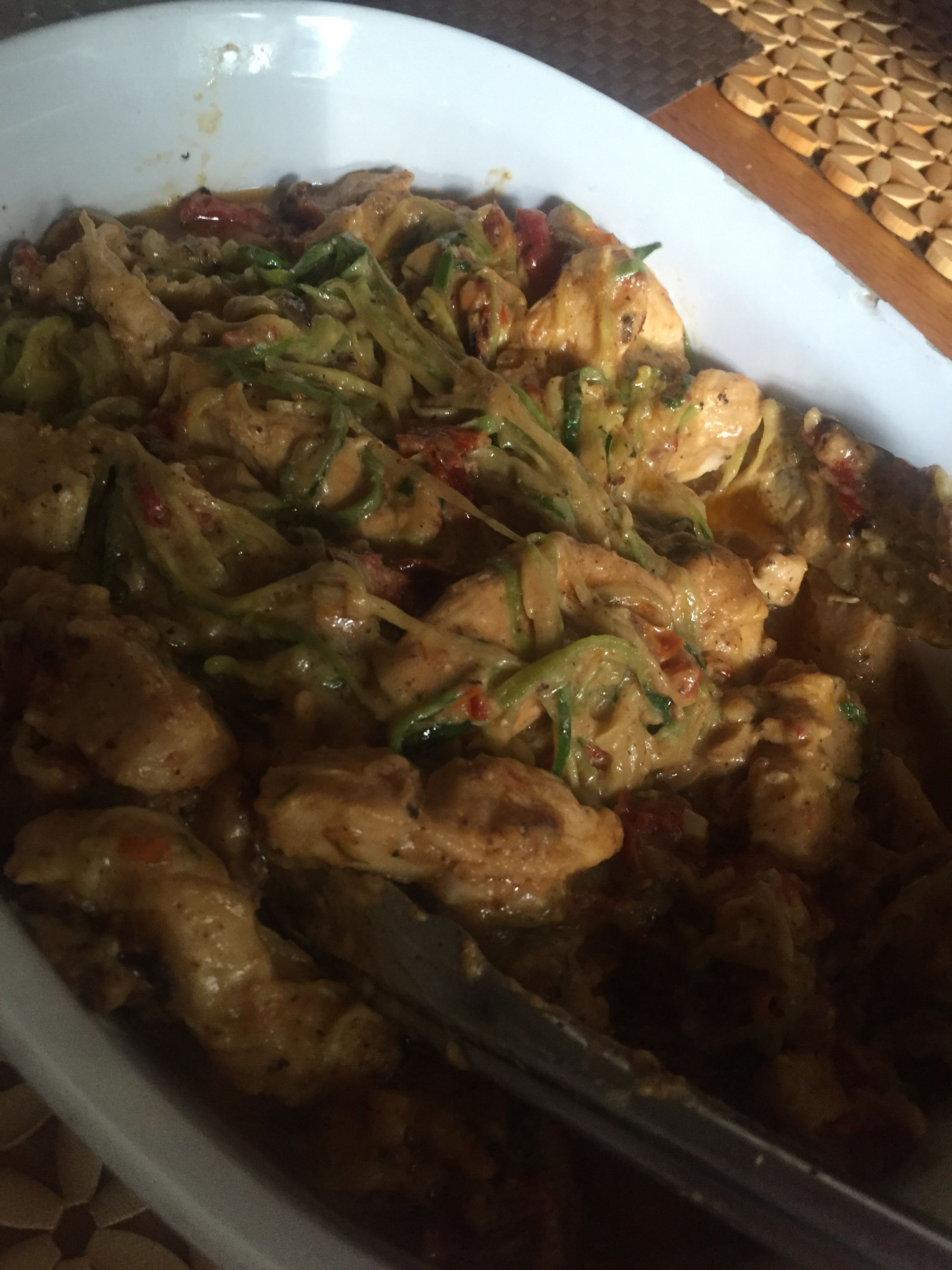 Chicken sautéed in Garlic and sun dried tomatoes and zucchini pasta and don't forget the Parmesan cheese!!