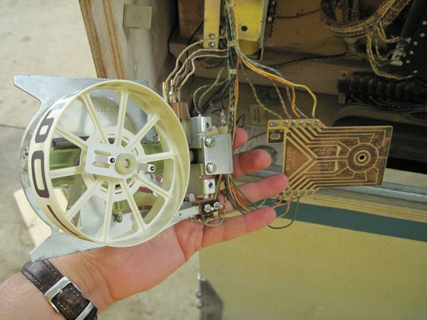 The score reel disassembled for cleaning.
