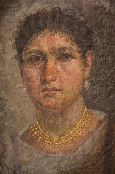 Mummy portrait of Lady Aline, from Hawara, Egypt, painted directly onto the canvas of the mummy wrapping. The Tomb of Aline is an ancient Egyptian grave from the time of Roman Emperor Tiberius or Hadrian, excavated at Hawara in 1892 CE. (Neues Museum, Berlin)