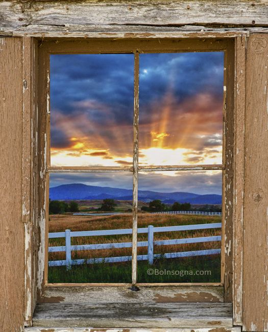 beams of sunlight views through a rustic window james bo insogna