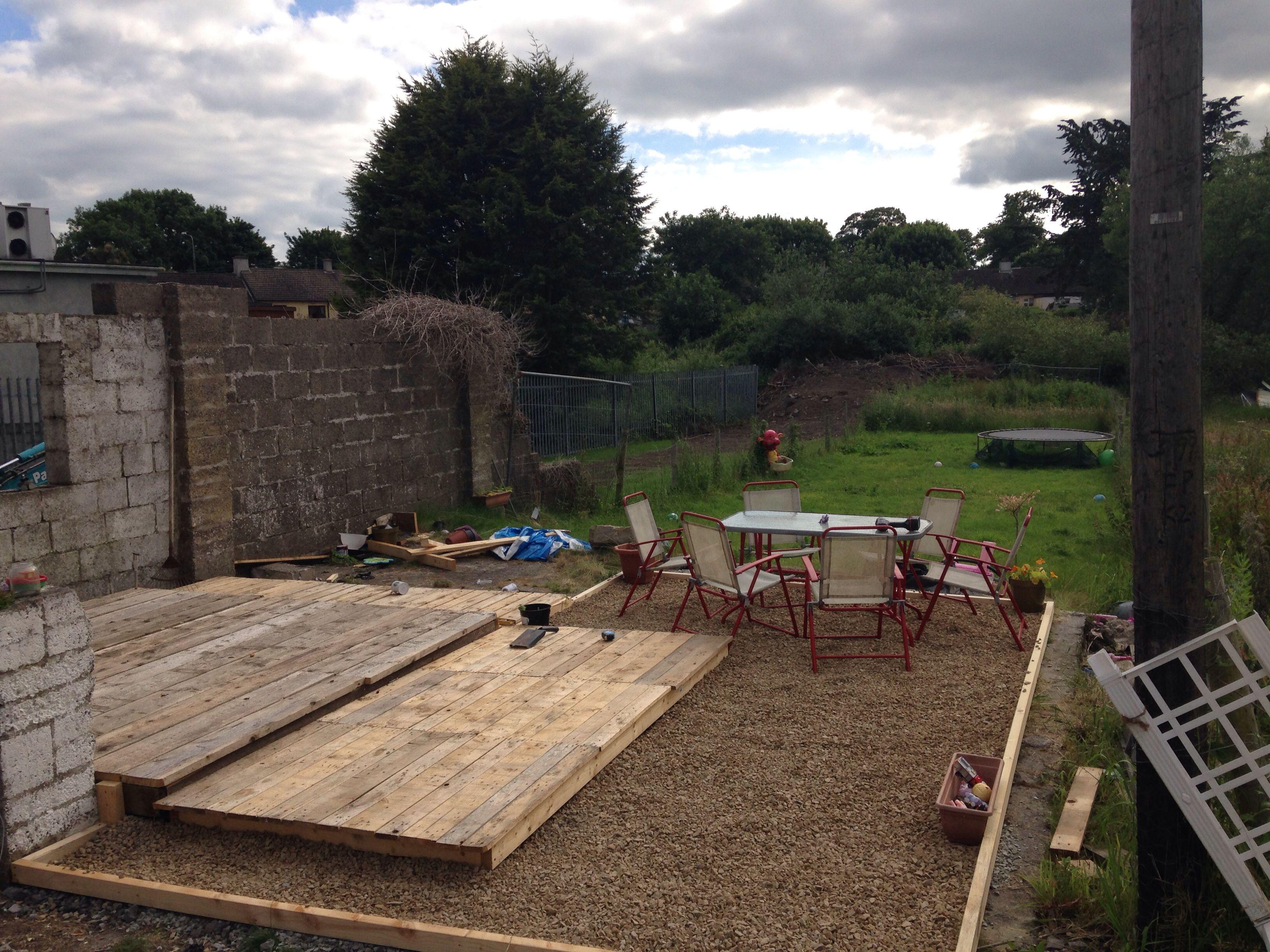 pallet deck and stone area garden diy pinterest decking