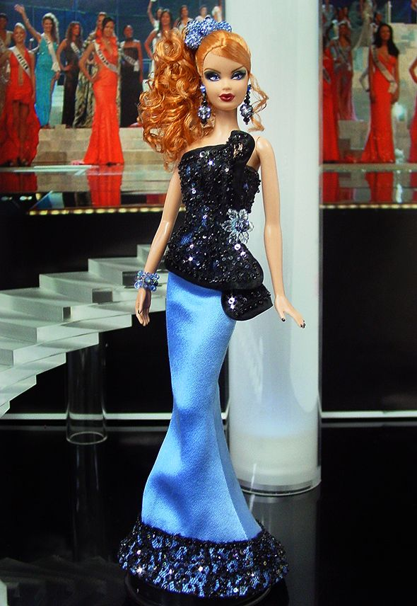 Miss Belarus 2013/2014 sold  Georges Chakra inspired $770. This doll is really pretty. I wonder if a pageant contestant with red hair every won a grand title.