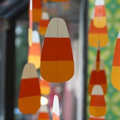 20 spooktacular diy halloween decorations hanging candy corn window decoration adorn your windows with hanging candy corns that trick or treaters can - Candy Corn Halloween Decorations