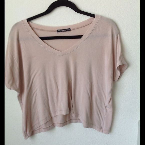 Brandy Melville Blush V neck Top Brandy Melville light pink V neck Top, One Size, Flowy Fit THERE ARE MINOR FLAWS : 1. It had a hole, but I sewed it (pictured), it's not very noticeable 2. Very small minor barely noticeable stain. PRICE FIRM ALREADY LOW Brandy Melville Tops