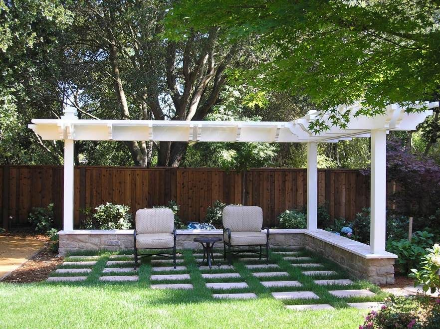 an l  posts set in a seat wall frame the lawn area  u0026 defines a space for