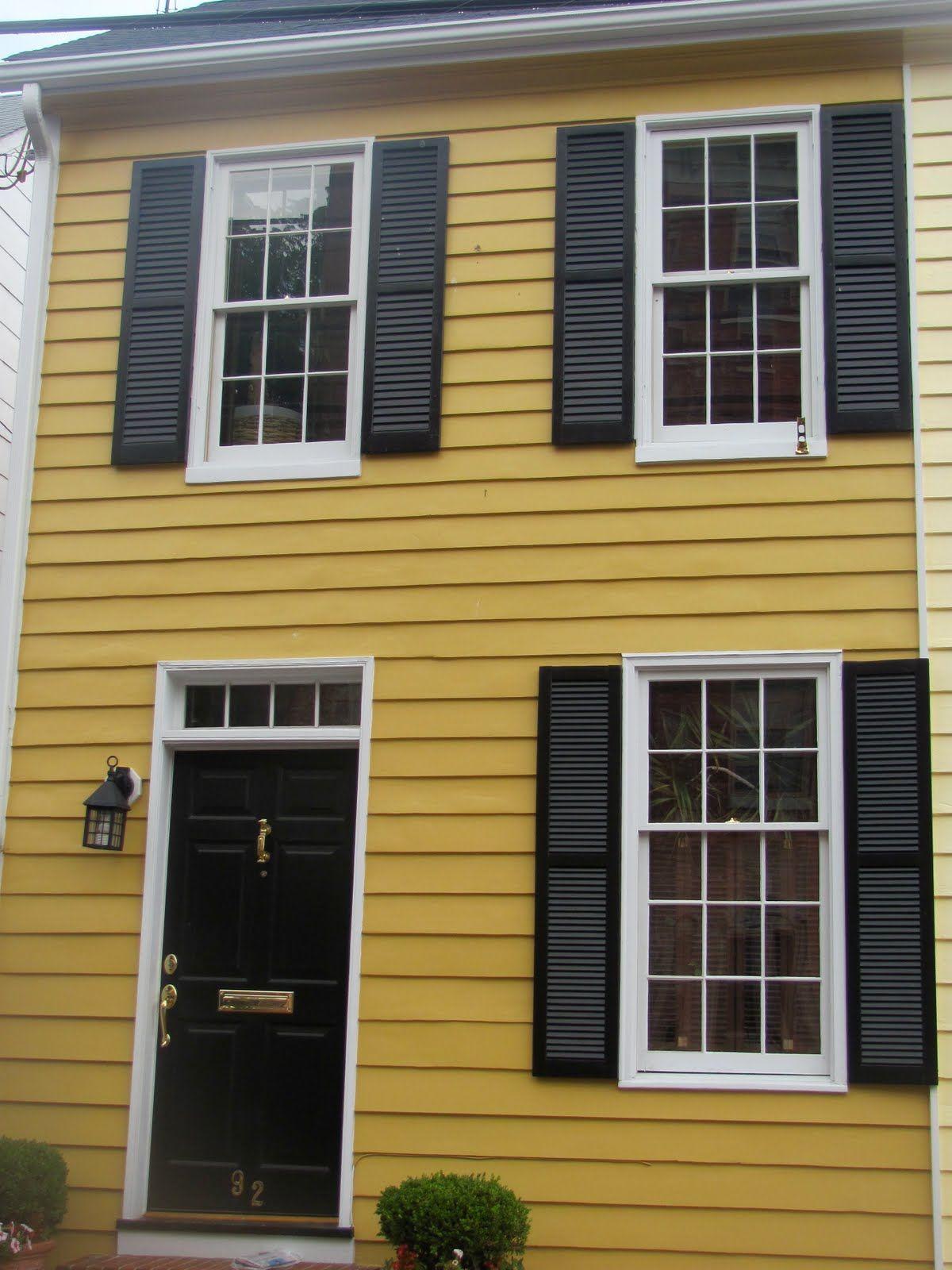 Dark Mustard Yellow Darker Than This White Trim Black Doors Shutters Warm Creamy Gray And Blac Yellow House Exterior White Exterior Houses Yellow Houses