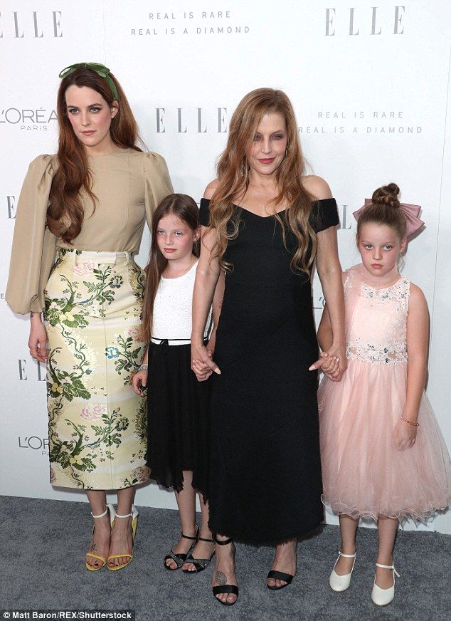 Lisa Marie Presley poses with her children at Elle bash