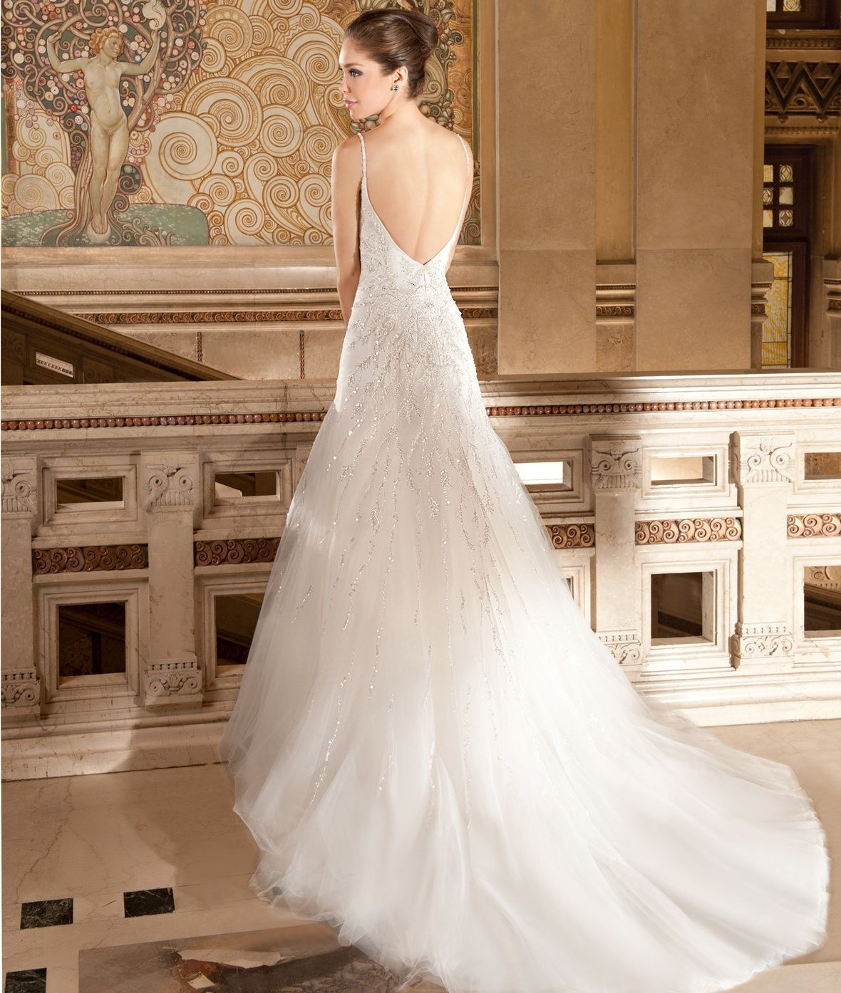 This modified A-line wedding gown features magnificent beaded vine ...