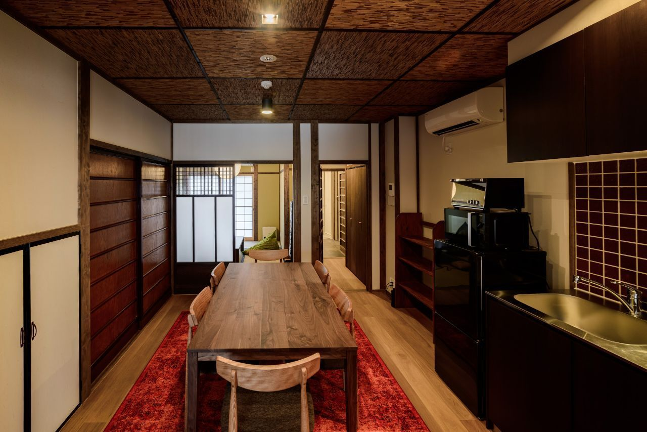Taking Inspiration From The Famous Fushimi Inari Taisha Shrine Otabisho An Incorporates The Golden Yellow Hues O House Rental House Traditional Japanese House