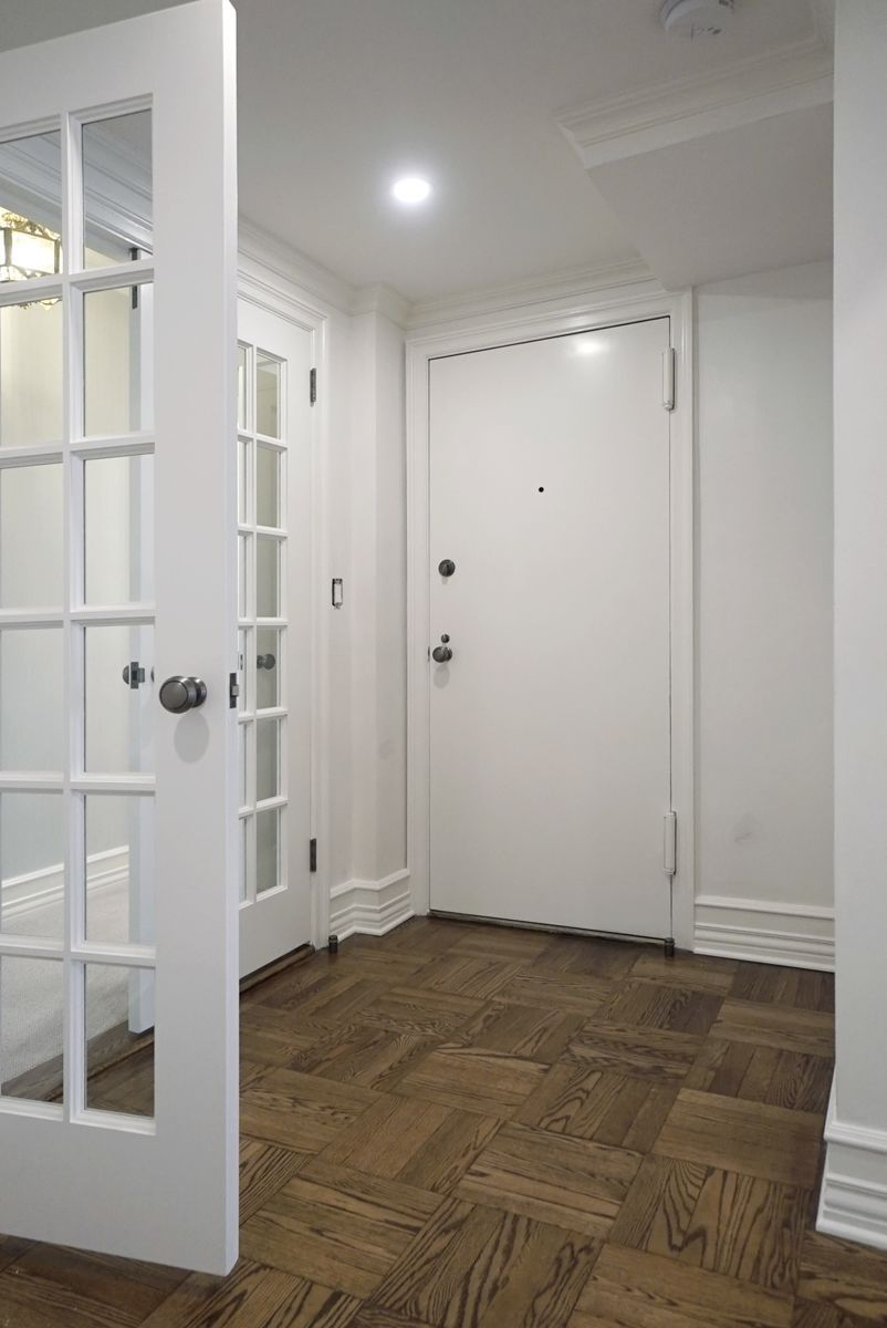 Refinished wood flooring throughout and new door sets