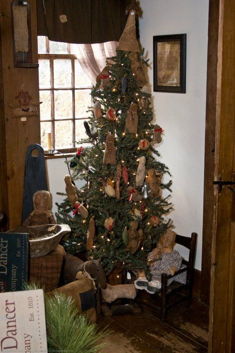 primitive country christmas tree with cute handmade rustic and early ornaments