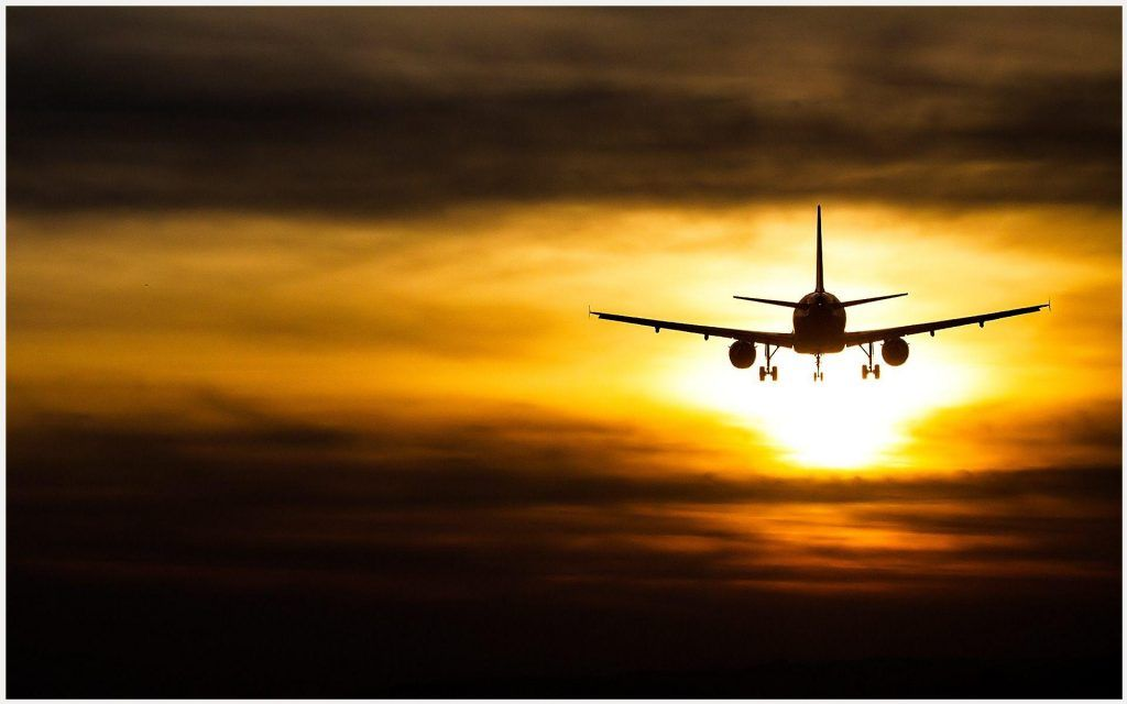 Plane Flying Sunset Wallpaper