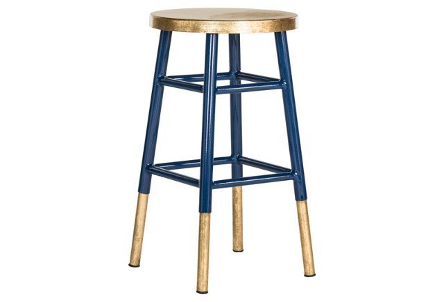 Sealed in a glossy gold-and-navy dip-dyed finish, this iron barstool