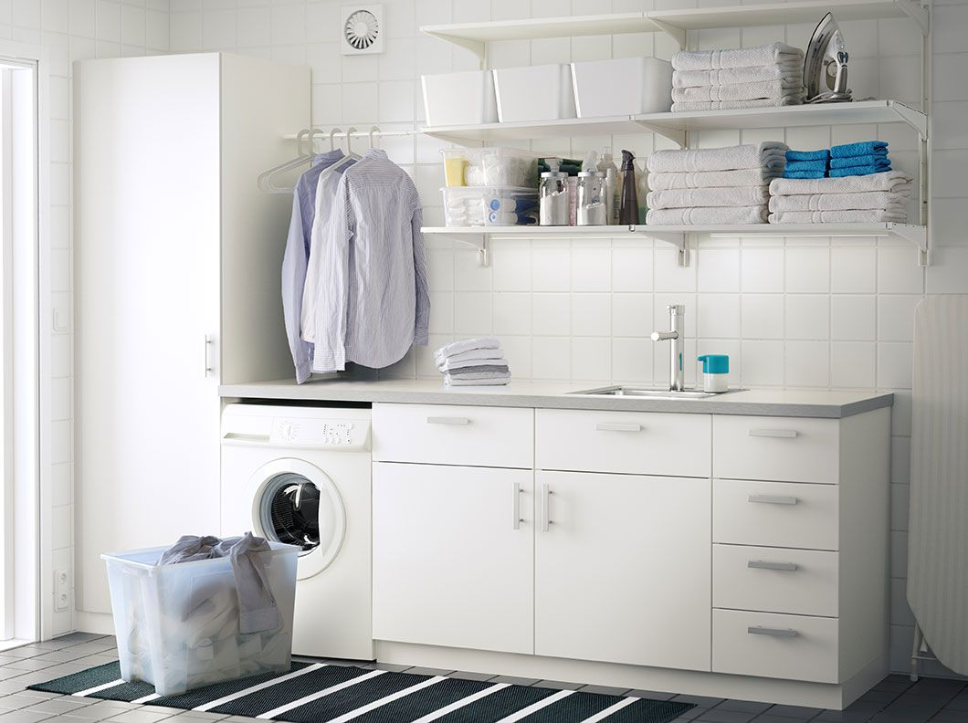 a laundry room with white wall shelves base cabinets with doors a laundry room with white wall shelves base cabinets with doors or drawers and a