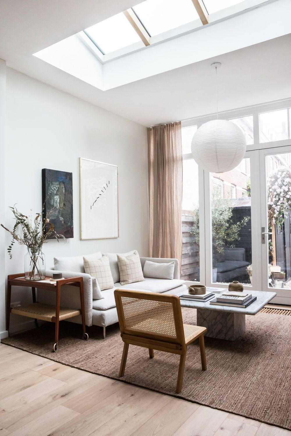 Home Interior Salas                                       Living room in natural tones with large skylight and IKEA Soderhamn sofa elevated with a Bemz cover and marble coffee table #serenehome #naturalmaterials #interiordesign #livingroom
