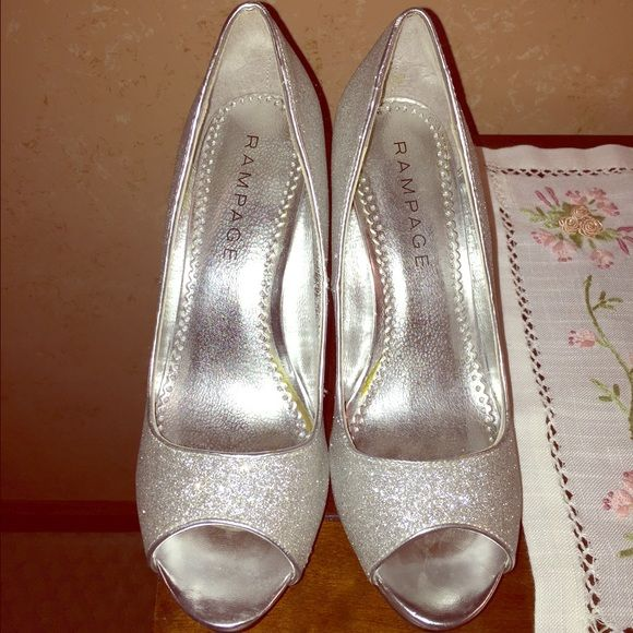 Silver, glitter, high heeled shoes The brand is Rampage and were bought from DSW. 4 inch heel. Only worn once (for prom). Great condition. Size 9. Rampage Shoes