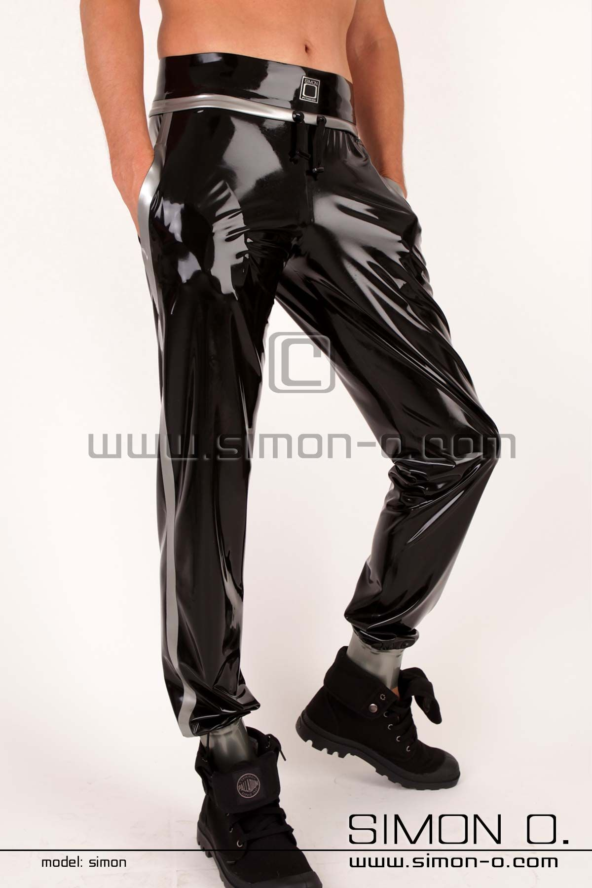 Trendy latex jogging pants made out of fine highly polished latex.