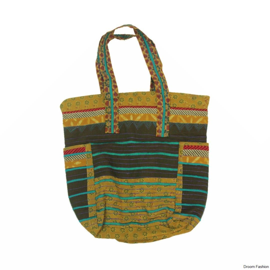 Buy this trendy #handbag from the house of #droomfashion. Made using brightly coloured cotton fabrics, You can come up with any number of places to carry it to. Secured section with zip, well stitched and durable. Can be matched with your everyday attire.