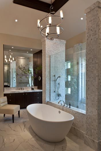 Photo of modern spa bathroom, great tile details and glass separation between tub/shower