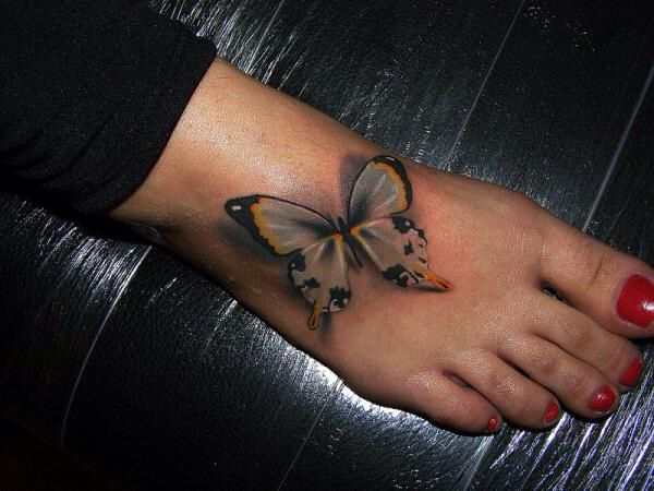 love this 3D butterfly foot tattoo