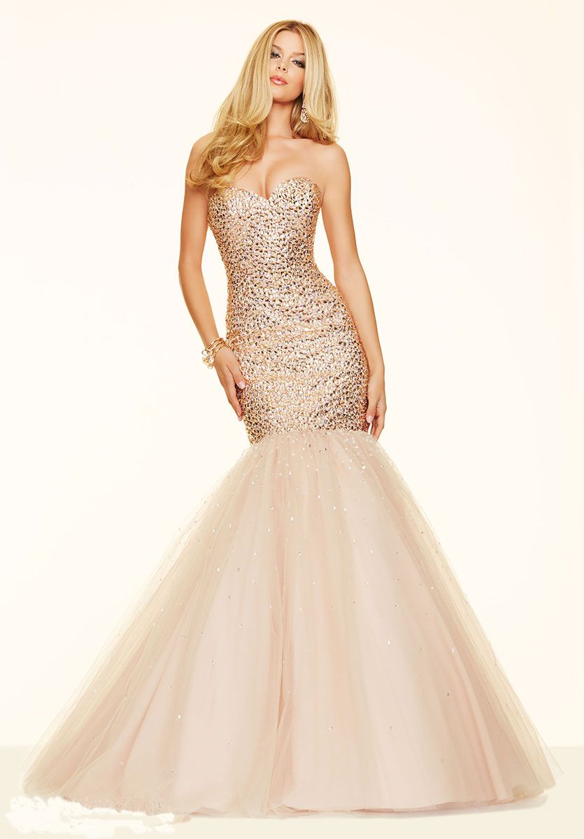 Long fitted ball gown with sweetheart neckline and beaded bodice