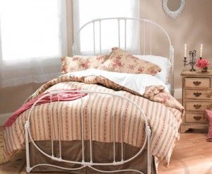 White iron bedframe would so cute with red toile bedding