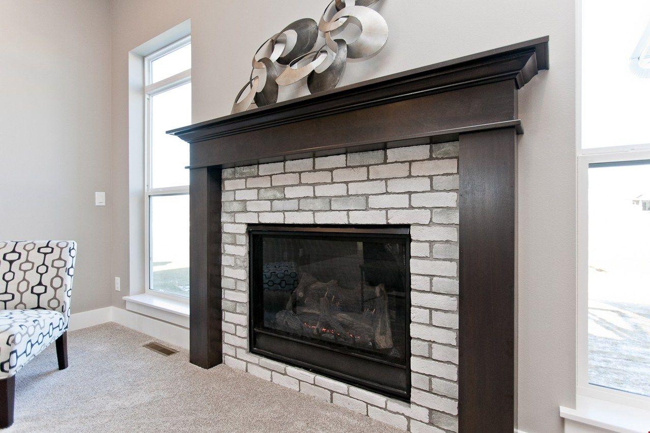 Traditional Fireplace With Twist Whitewash Brick Dark Wood Mantle