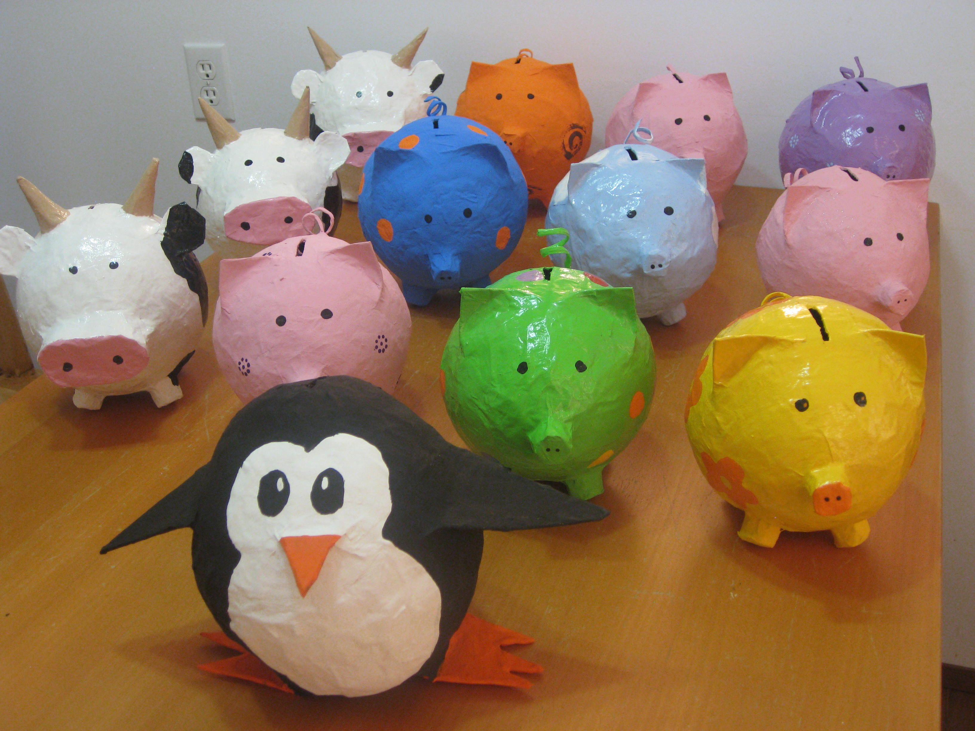 2011 Paper Mache Piggy Bank Army With Penguin Leader Paper