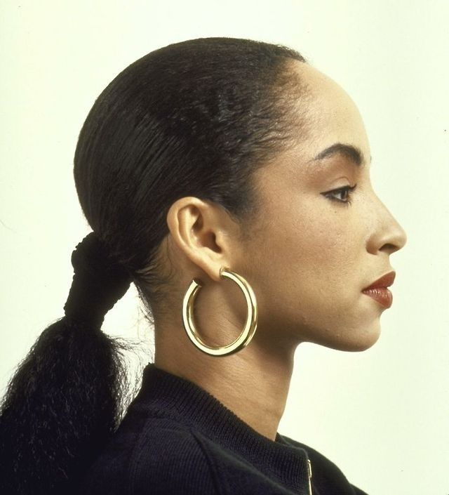 Sade really knows how to rock thick, hoop earrings. I love the way her hair is tightly pulled back, with a hint of red lipstick. This is a perfect everyday look.