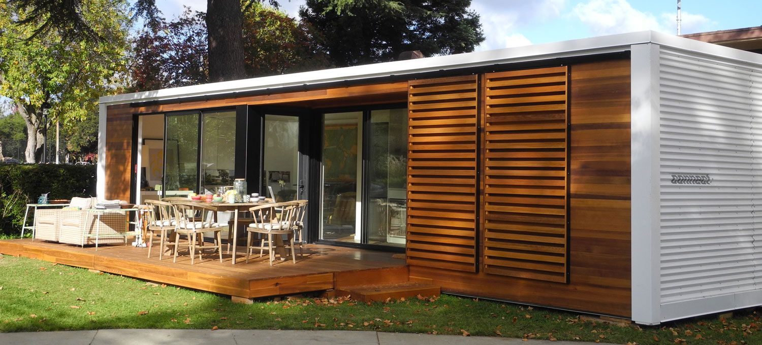 architecture smaal prefab home with wooden table and chairs in ...