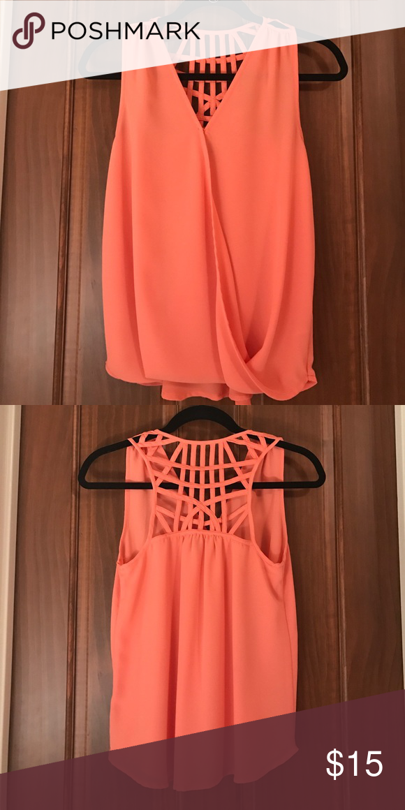Orange sleeveless shirt with detail back Detail backing. Cross over in the front. Bright orange. Worn once Naked Zebra Tops