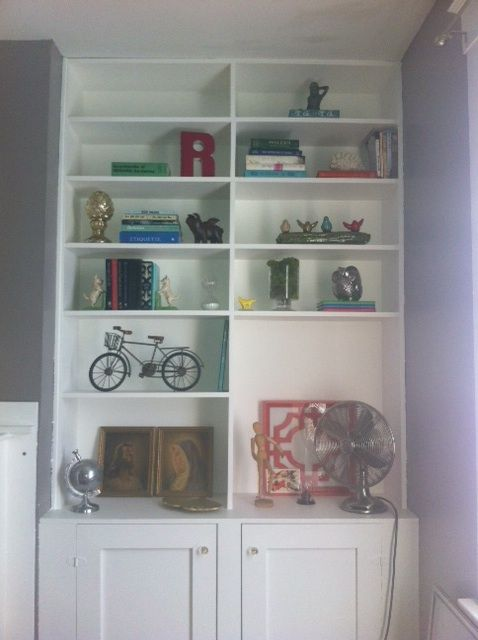 Styled bookshelves in guest room