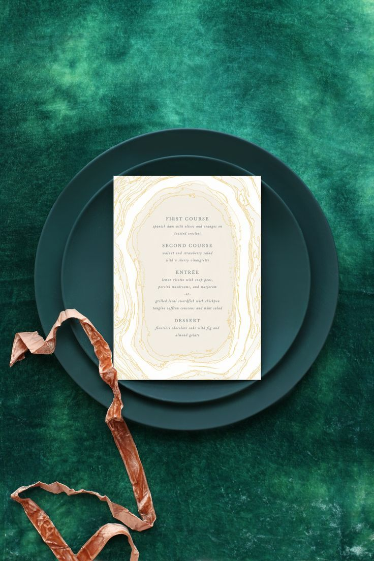 Green wedding tablescape featuring Simple Agate menu from Minted.