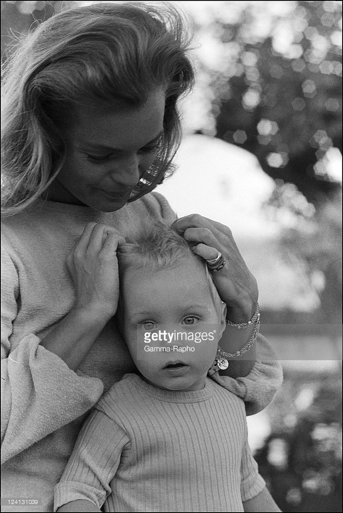 On set of 'La Piscine' directed by Jacques Deray In Saint Tropez, France In August, 1968 - Romy Schneider and son David.