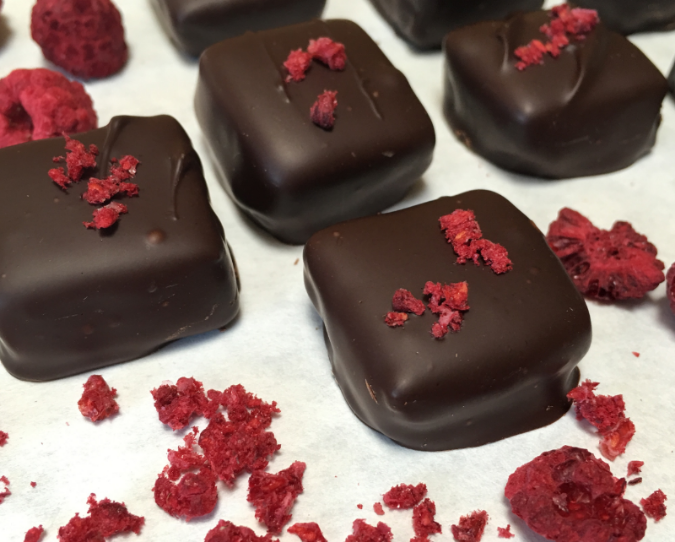 Scrumptiously delicious raspberry ganache truffles. Top them with freeze dried raspberry crumbles for an extra festive note #freezedriedraspberries