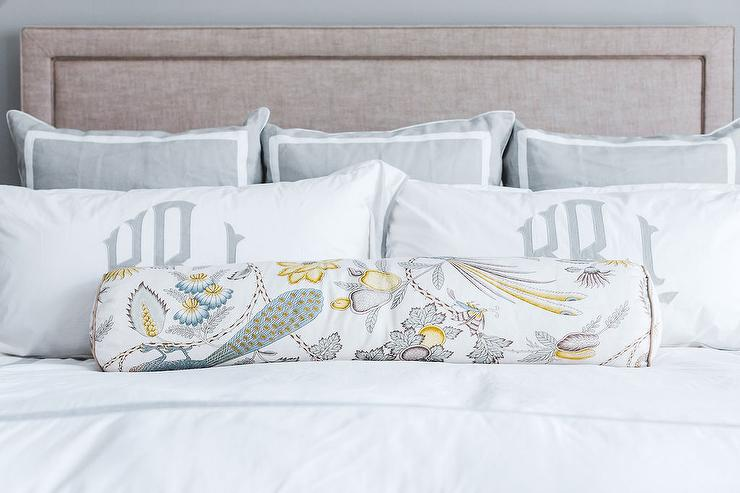 Best In Front Of A Beige Linen Headboard Gray And Blue Pillows Are Placed Behind Monogrammed Shams 640 x 480