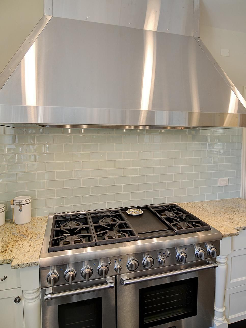 A detail photo of a stainless steel range and range hood ...