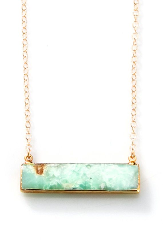 This beautiful Chrysoprase pendant is edged in gold and hangs from a gold filled chain. Chain Measures 17 inches.  Makes a perfect Mothers day gift, bridesmaid jewelry, or a unique gift for that special woman in your life. * Natural stones may vary slightly from stock photo *  ALL SALE ITEMS ARE FINAL SALE