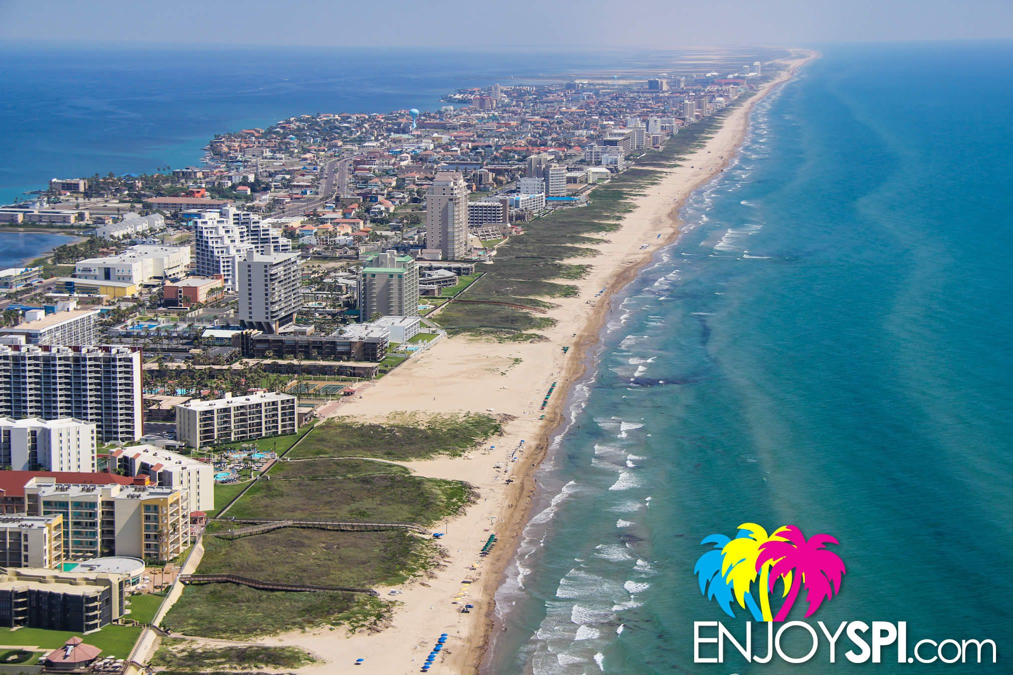 an aerial shot of the south beach of south padre island for more