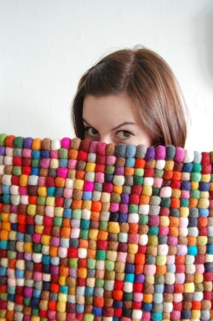 diy rug.with little balls of felted wool...it is darling
