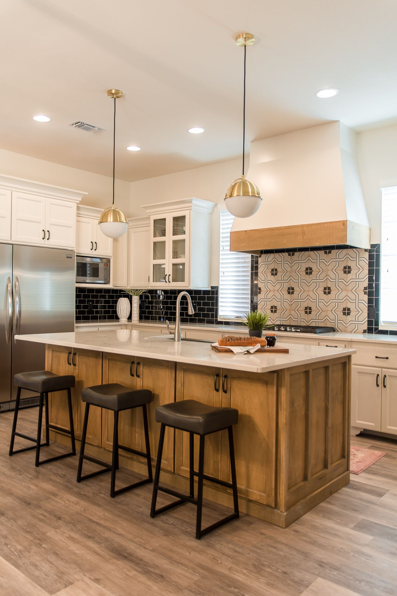 This Kitchen Combines Two Tone Cabinets And A Standout Backsplash To Make A Bold Statement We Love The Stain Home Kitchens Kitchen Design Kitchen Inspirations