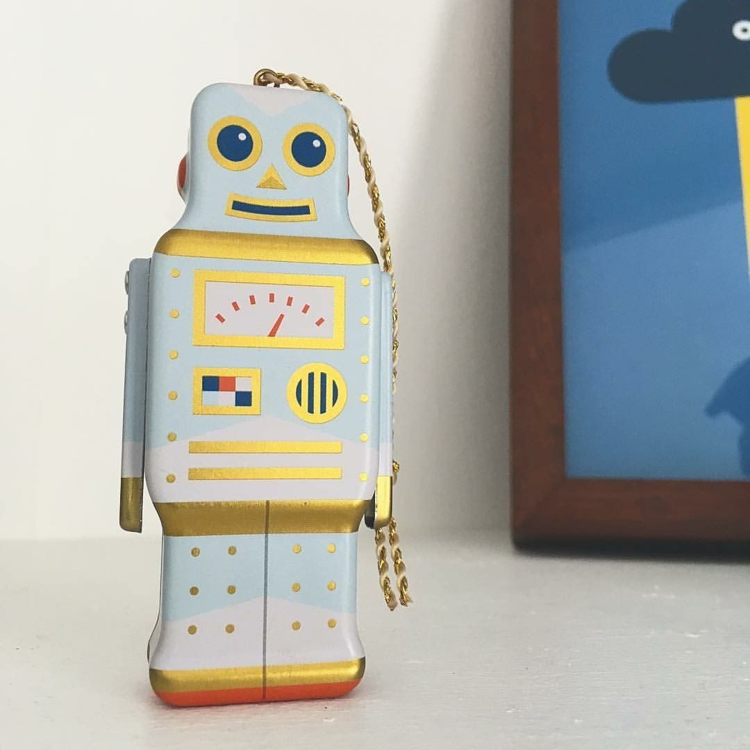 My little office buddy! Love this little robot decoration in my studio.