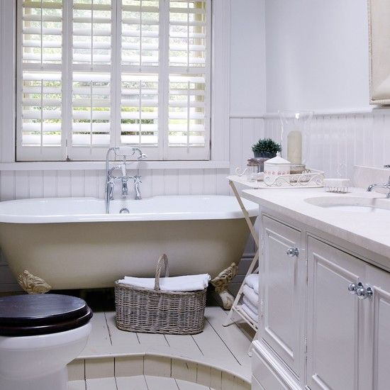 All-white bathroom with roll-top bath and shutters | Bathroom ...