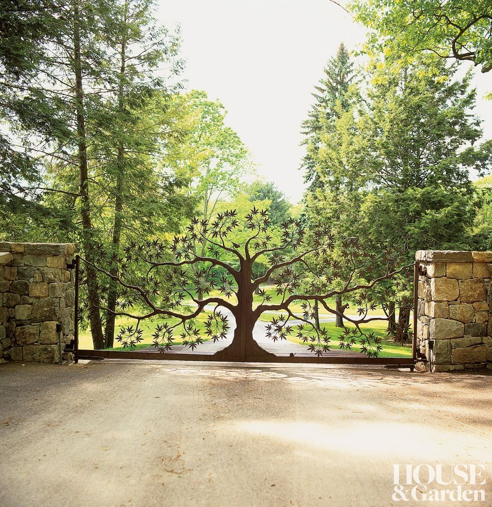 A Wrought Iron Entry Gate In The Shape Of A Japanese Maple Tree Is