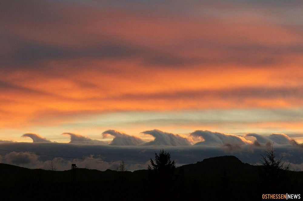 Kelvin-Helmholtz instability clouds form on windy days when there are two separate layers of air with the top layer moving faster. It scoops the tops of the cloud on the bottom into wave-like formations. Fairly rare phenomenon. Photo by Sandra Mihm.