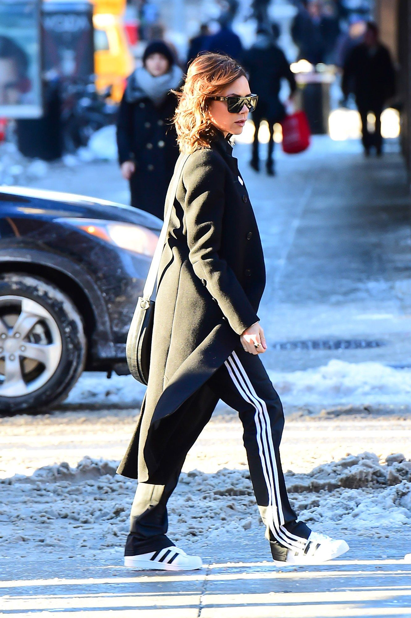 size 40 9b2d2 90448 Victoria Beckham in a long coat, track pants and Adidas sneakers.