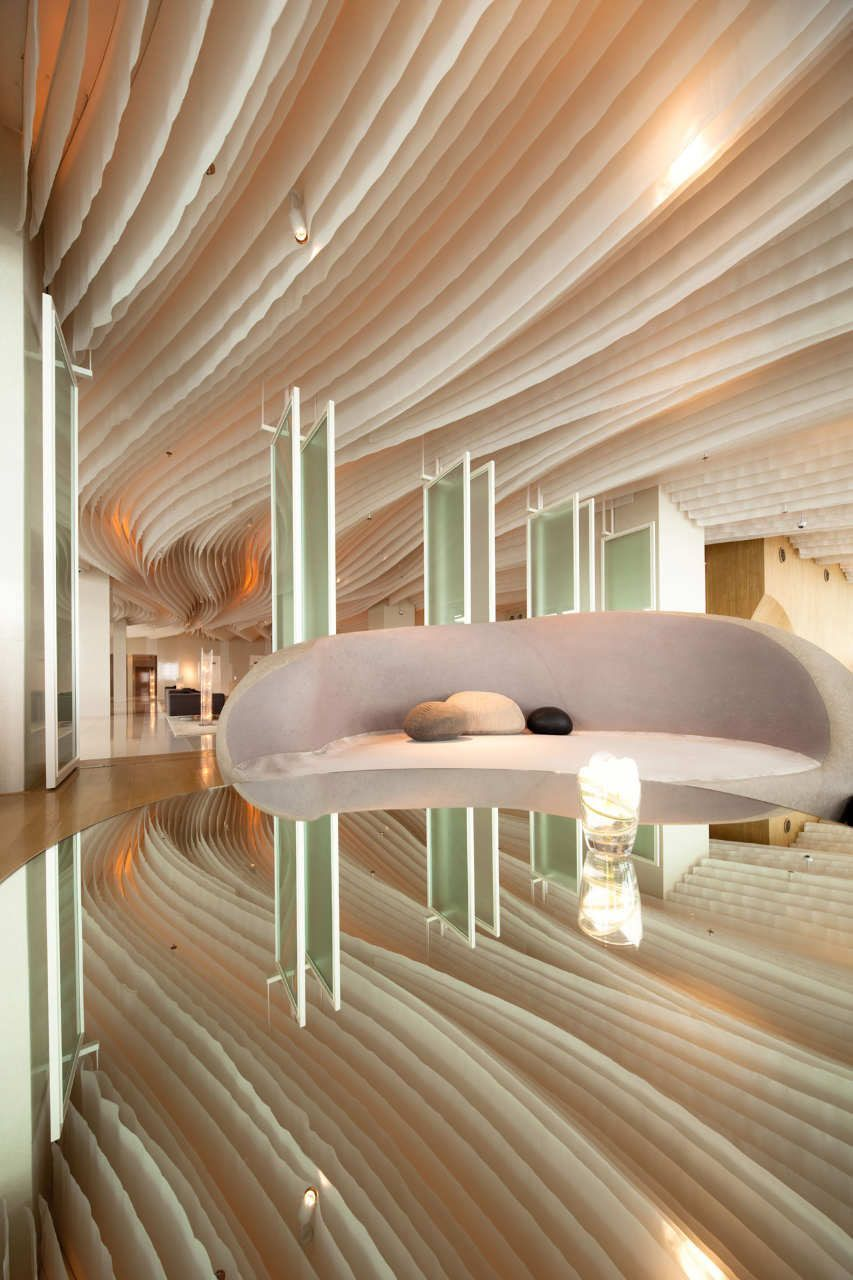Dynamic wave lines of this hotel lobby\'s #ceiling guide the movement ...