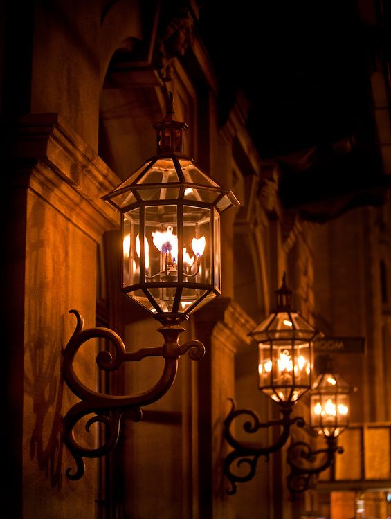 Original gas lamps provide lighting on the exterior of the Academy
