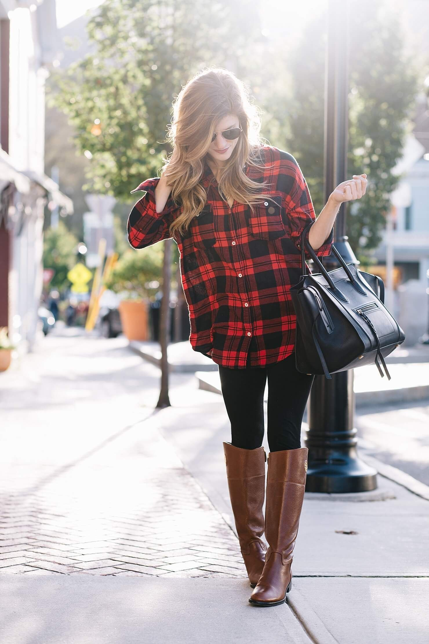 3627b9d9e93f4 red and black plaid shirt, black leggings, tory burch brown leather riding  boots, black celine phantom tote, gold aviators